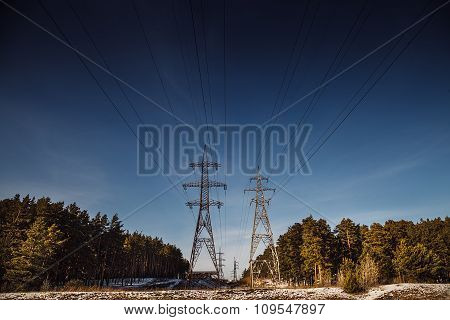 Power Lines On Blue Sky Background