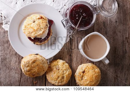 Delicious English Scones With Jam And Tea Close-up. Horizontal Top View