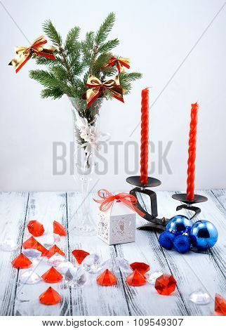 Christmas Tree In White Decorative Goblet, White Gift Box, Blue Balls, Candlestick With Red Candles