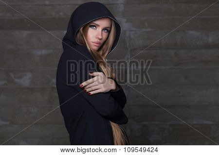 Portrait of beautiful and sexy woman in dark hood