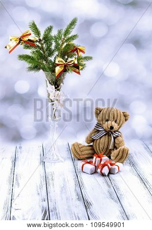 Christmas Tree In White Decorative Goblet, White And Red Gift Box, Brown Toy Bear And Snow On Retro
