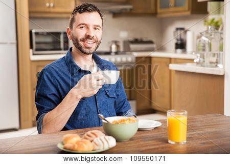 Hispanic Man Eating Breafast At Home