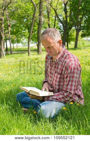 Man With A Book In The Park
