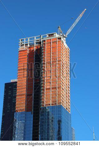 Skyscraper Building Site Half Completed With Top Crane