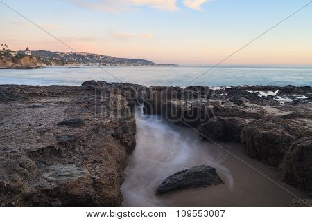 Misty water over rocks