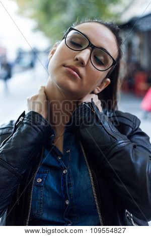 Beautiful Young Woman With Neck Pain In The Street.