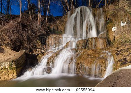 Cascading Waterfallt Against The Night Sky