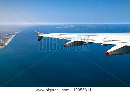 Big passenger jet airplane gaining altitude over Tel Aviv and Mediterraneantel  Sea