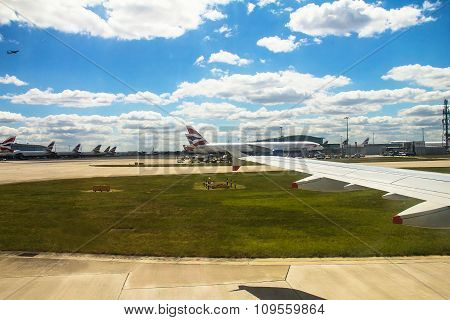 Taxiing aircraft after landing in Heathrow Airport . London. UK