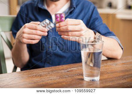 Guy Choosing The Right Medicine