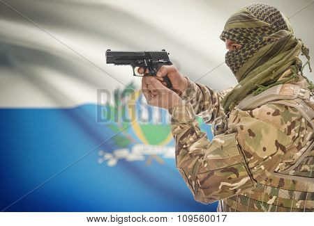 Male In Muslim Keffiyeh With Gun In Hand And National Flag On Background - San Marino