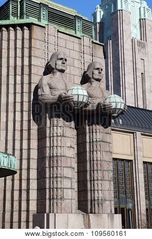 HELSINKI FINLAND - MARCH 17 2013: Statues holding the spherical lamps at the Helsinki Central railwa