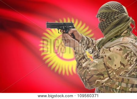 Male In Muslim Keffiyeh With Gun In Hand And National Flag On Background - Kyrgyzstan