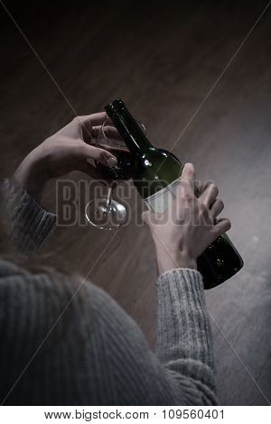 Holding A Glass And Bottle