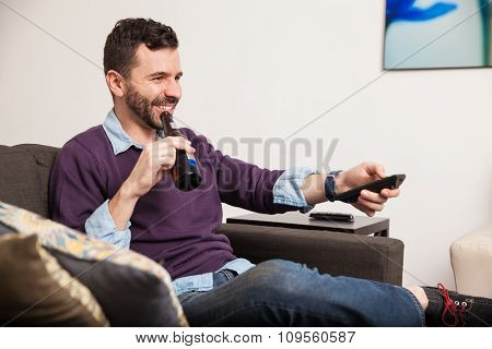 Relaxing At Home With Beer And Tv