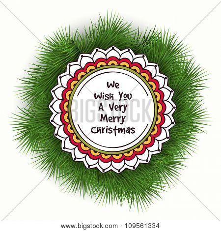 Creative sticky design on fir tree branches for Merry Christmas celebration.