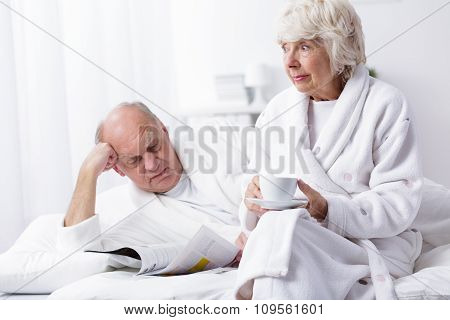 Mature Marriage Resting In Bed