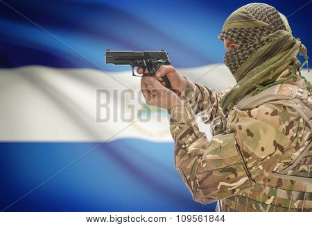 Male In Muslim Keffiyeh With Gun In Hand And National Flag On Background - Nicaragua