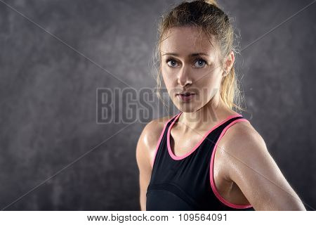Sweating Athletic Blond Woman Wearing Tank Top
