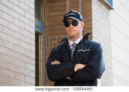 Security Guard Standing With Arm Crossed