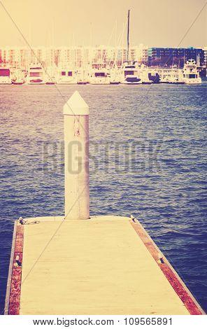 Vintage Toned Yacht Pier Against Sun, Travel Concept