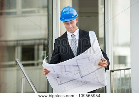 Engineer With Blueprint In His Hands