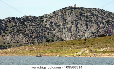 Fishers Boat Across Alange Reservoir, Spain
