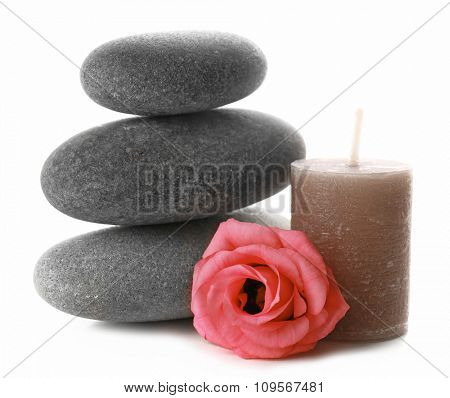 Aroma candle with pebbles and flower isolated on white background