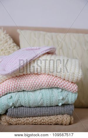 Knitted clothes on a sofa