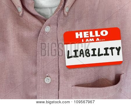 Liability word written on a red name tag or sticker to introduce a person, worker or employee as a risk