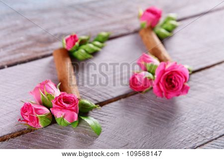 Creative music notes made of flowers on wooden background, close up