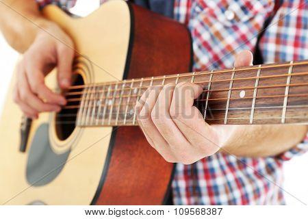 Young musician with guitar, close-up