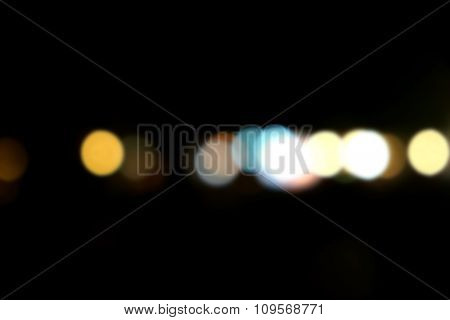 Abstract background with bokeh defocused lights at night