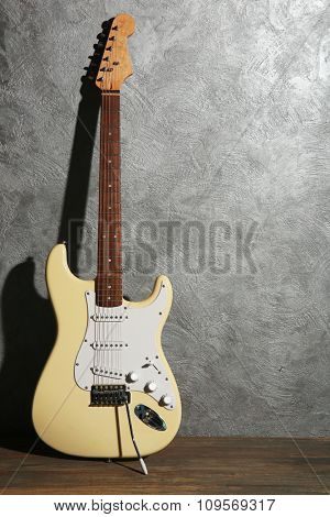 Guitar on grey background