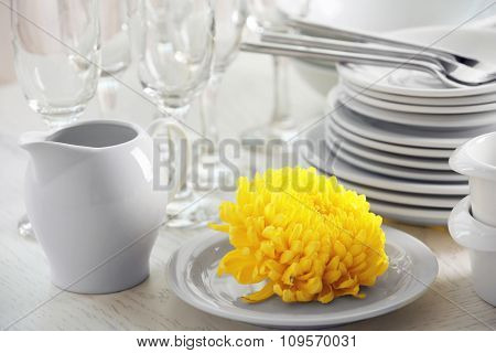 Set of white dishes on table, close-up