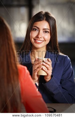 Beautiful girl poses with cup of coffee