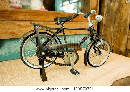 Vintage Small Bike On The Wood Floor