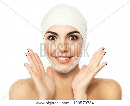 Young emotional woman with an elastic bandage on her head, isolated on white
