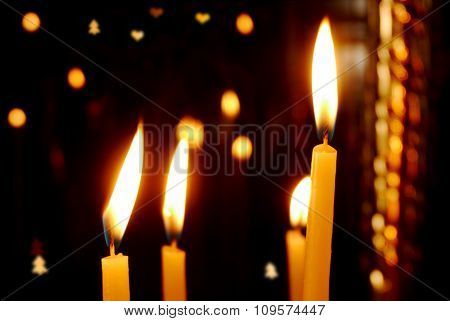Burning Candles Over Christmas Background