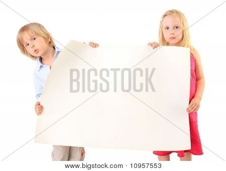 Children Holding A Blank Cardboard Paper Sign Isolated On White Background