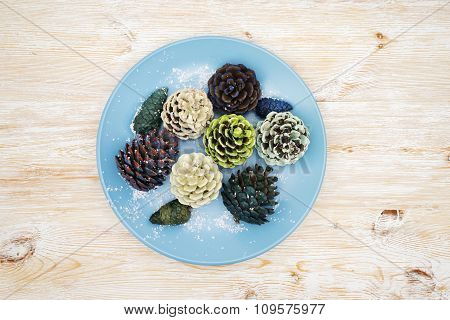 Multicolored Pinecones On The Plate