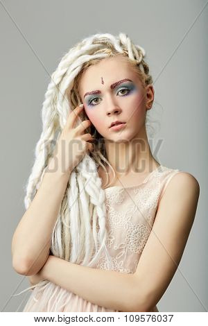 beautiful blond teenage girl with dreadlocks
