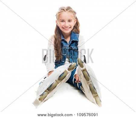 cute teenager girl on rollerskates sitting on the floor isolated on white background