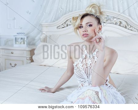 beauty emotional blond bride in luxury interior happy bed dreaming