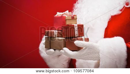 Santa Claus with gifts on red background