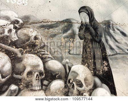 Varna - November 11: Detail Of Graffiti On The Wall Of A Woman Cries Near The Pile Of Skulls. Grungy