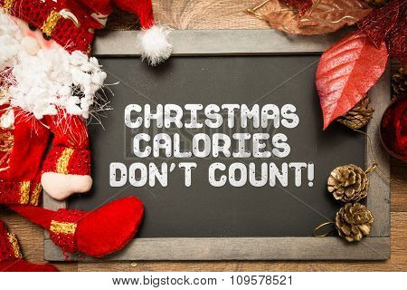 Blackboard with the text: Christmas Calories Don't Count
