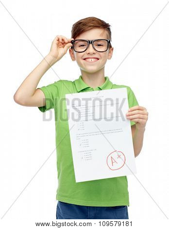 childhood, school, education and people concept - happy smiling boy in eyeglasses holding paper with test result