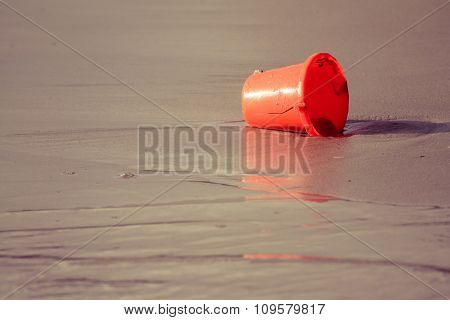 Orange Toy Bucket On The Beach