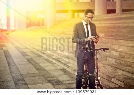 Businessman travelling by bike